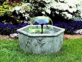 Bell fountain in stone container